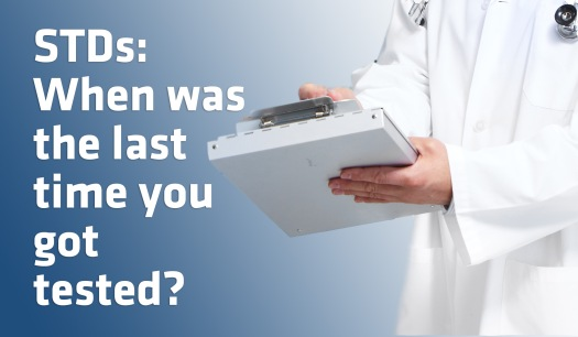 "a doctor holds a notebook. the text says ""stds: when was the last time you got tested?"""